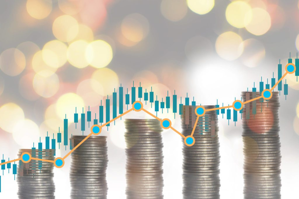 stacks of coins next to each other with ascending graph graphic
